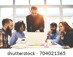 handsome business coach showing ... | Shutterstock . vector #704021365