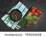 baked chicken liver hearts in... | Shutterstock . vector #704034658