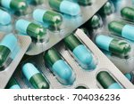 close up of a blue capsules...   Shutterstock . vector #704036236