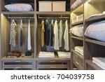 wooden wardrobe in walk in... | Shutterstock . vector #704039758