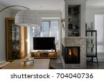 luxury rustic living room.... | Shutterstock . vector #704040736