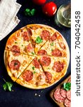 pepperoni pizza with... | Shutterstock . vector #704042458