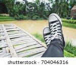 selfie of sneakers | Shutterstock . vector #704046316