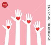 hands with hearts   Shutterstock .eps vector #704047768