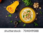 cream of pumpkin soup with sour ... | Shutterstock . vector #704049088
