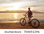 traveler with backpack stand on ... | Shutterstock . vector #704051296