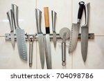 set of professional knives ... | Shutterstock . vector #704098786