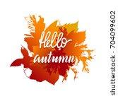 hello autumn lettering on a... | Shutterstock .eps vector #704099602