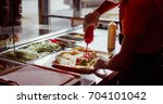 chef making food order kebab | Shutterstock . vector #704101042