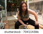 fat woman smile face exercise... | Shutterstock . vector #704114386