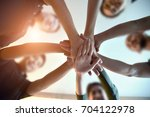 young group are join hands for... | Shutterstock . vector #704122978