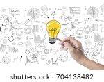 hand draw lightbulb on wall... | Shutterstock . vector #704138482