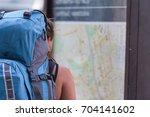 girl traveler alone see the big ... | Shutterstock . vector #704141602