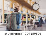 young woman traveler waiting... | Shutterstock . vector #704159506