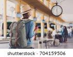 Young Woman Traveler Waiting...