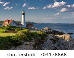 portland head lighthouse in... | Shutterstock . vector #704178868