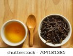 tea in a white cup on wooden... | Shutterstock . vector #704181385