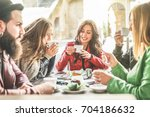 young friends toasting coffee... | Shutterstock . vector #704186632