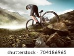 mountainbiker in the mountains | Shutterstock . vector #704186965
