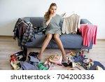 girl can't decide | Shutterstock . vector #704200336