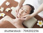 a woman who receives face... | Shutterstock . vector #704202256