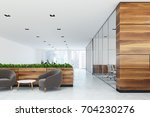white and wooden office with a... | Shutterstock . vector #704230276