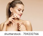 charming woman applying powder... | Shutterstock . vector #704232766