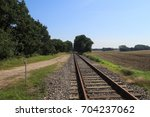 railroad track in north germany | Shutterstock . vector #704237062