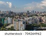 urban day skyline of dhaka city ... | Shutterstock . vector #704264962