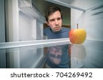 hungry man is looking for food... | Shutterstock . vector #704269492