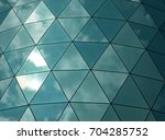 angular mirror cladding on a... | Shutterstock . vector #704285752