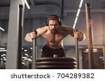 sled push man pushing weights... | Shutterstock . vector #704289382