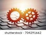 gears on computer keyboard  | Shutterstock . vector #704291662