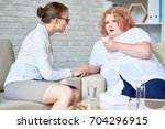 portrait of crying obese woman... | Shutterstock . vector #704296915