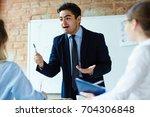 business expert motivating... | Shutterstock . vector #704306848