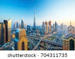 futuristic dubai city center ...   Shutterstock . vector #704311735