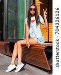 brunette with long hair tanned... | Shutterstock . vector #704326126
