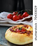 Italian  bread with tomato and cheese on the board - stock photo