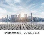 wooden floor and city skyline ... | Shutterstock . vector #704336116