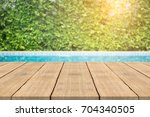 empty wooden table in front... | Shutterstock . vector #704340505