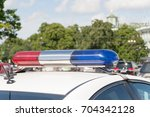 fires of the police car on the... | Shutterstock . vector #704342128