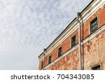 wall of prison with barred... | Shutterstock . vector #704343085