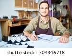 portrait of smiling young man... | Shutterstock . vector #704346718