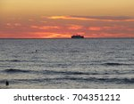 a wonderful sunset in procida... | Shutterstock . vector #704351212