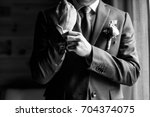 groom getting ready in the...   Shutterstock . vector #704374075