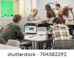 students working together in... | Shutterstock . vector #704382292