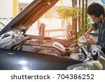 the technician is pouring clean ... | Shutterstock . vector #704386252