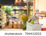 Small photo of Refreshments portation counter shop on front of blur mall background.