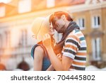 romantic young man kissing...   Shutterstock . vector #704445802