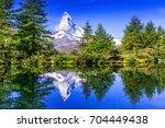 zermatt  switzerland.... | Shutterstock . vector #704449438